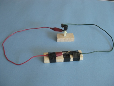 The Test Setup With Wires Connected To Piezoelectric Igniter And Leading A Spark Gap