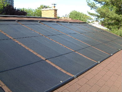 Solar pool heating panels on a roof - view from the roof. & Solar Pool Heating