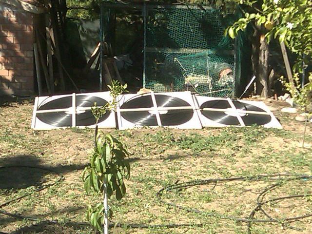 Three Flat Spiral Solar Heat Collectors.