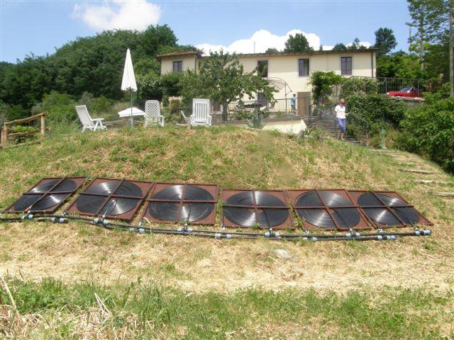 Six flat spiral solar heat collectors.
