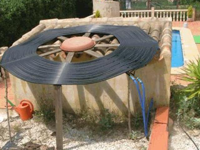 Flat spiral solar heat collector.