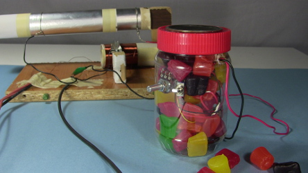 My homemade crystal radio amplifier in a jar filled with Jujubes.